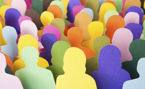 Cardboard cut outs of various colours in the shape of people